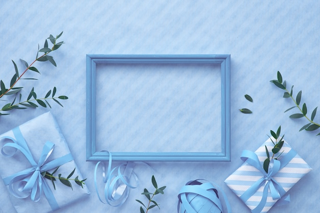 Flat lay in light blue hues with wrapped gift boxes