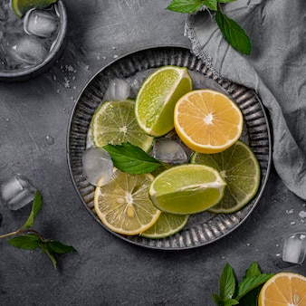 Flat lay lime and lemon slices on plate