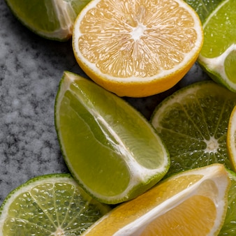 Flat lay lime and lemon slices
