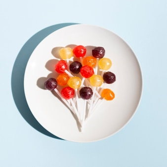 Flat lay lollipops on plate