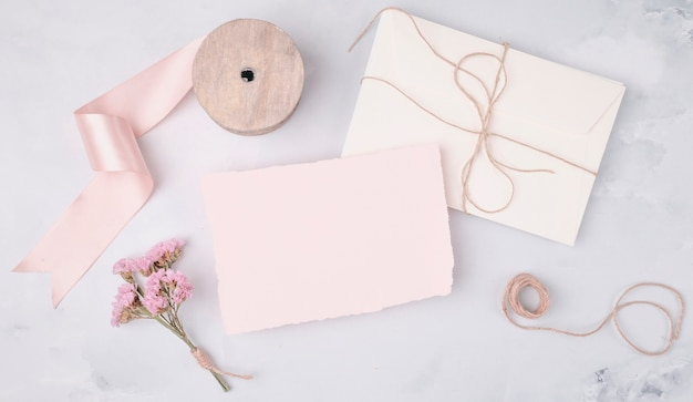 Flat lay lovely arrangement with wedding invitations