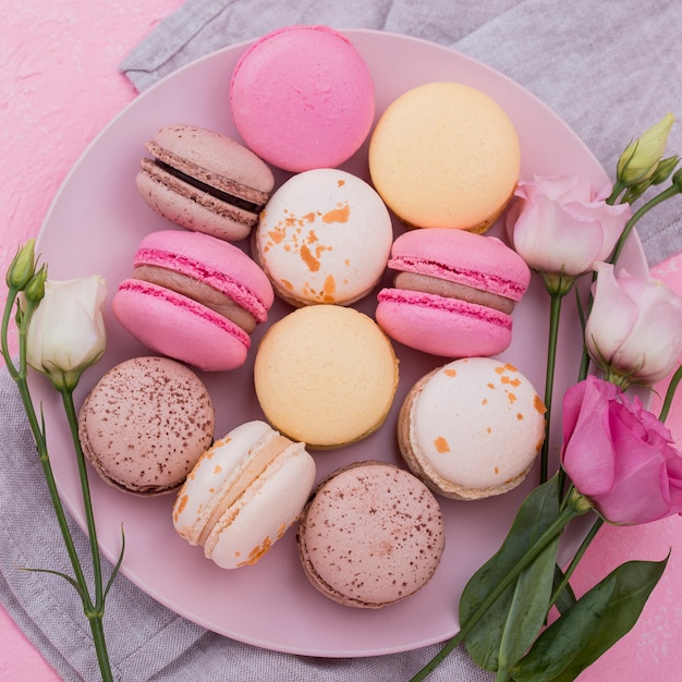Flat lay of macarons on plate with roses