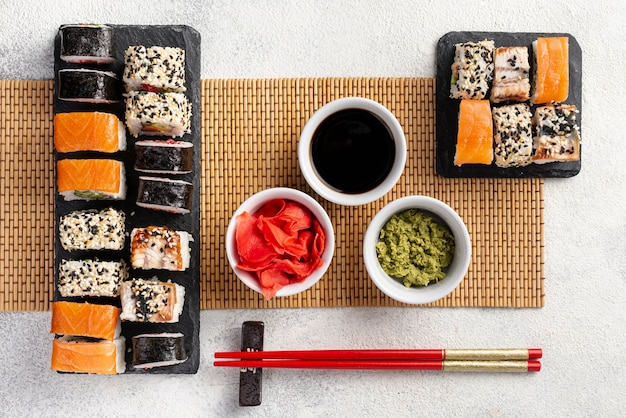 Flat lay maki sushi rolls assortment with chopsticks