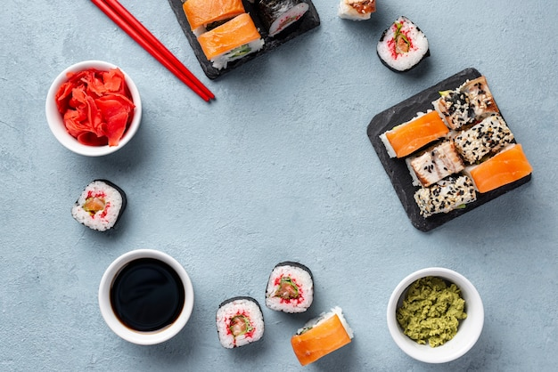 Flat lay maki sushi rolls chopsticks and soy sauce frame