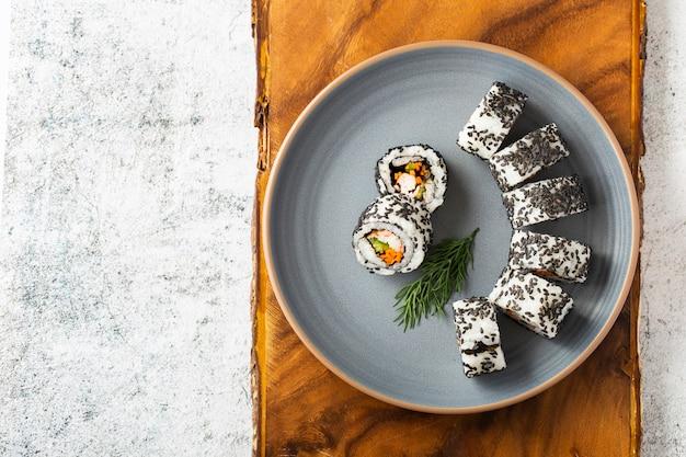 Flat lay maki sushi rolls with sesame seeds