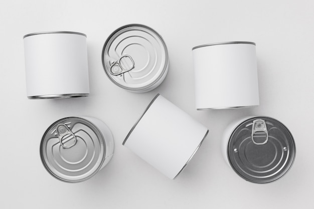 Flat lay of many tin cans with blank labels