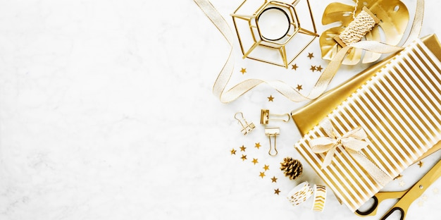 Flat lay on marble background with golden deco