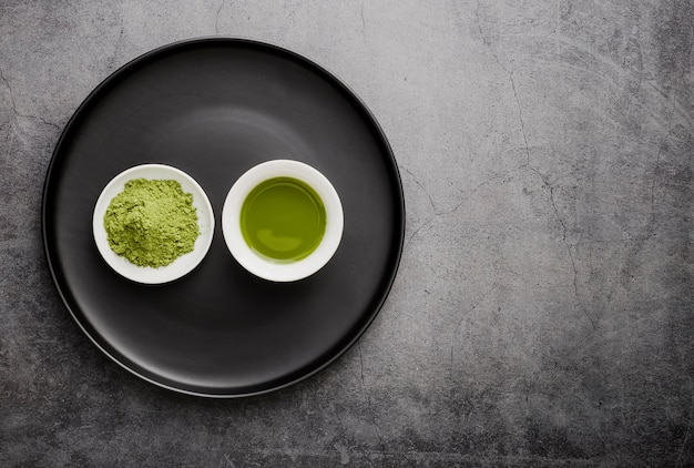 Flat lay of matcha tea in cup with copy space