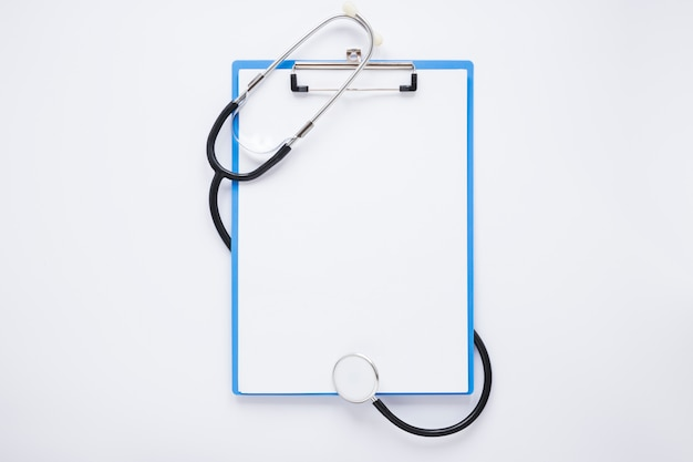 Flat lay medical composition with clipboard template