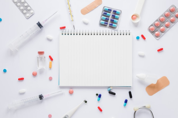 Flat lay medical composition with notepad tempalte