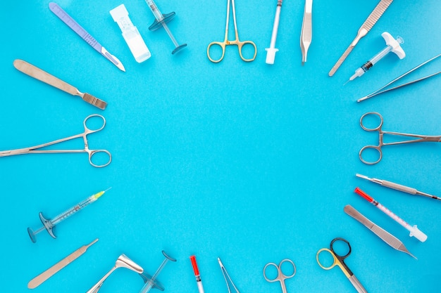 Flat lay of medical instruments on blue background. mock up health care medical background.