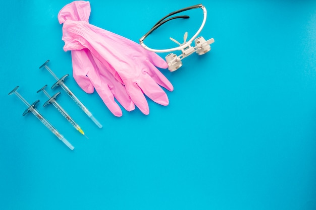 Flat lay of medical instruments on blue