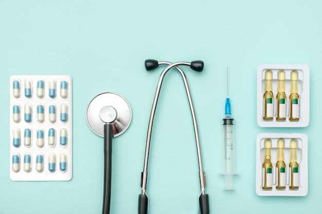 Flat lay of medical tools on colored background