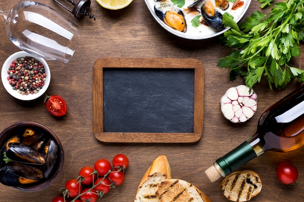 Flat-lay mediterranean diet with mussels with blackboard