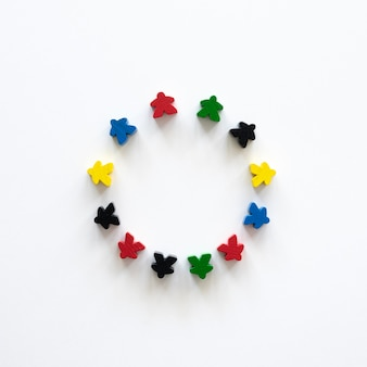 Flat lay meeple board game pieces