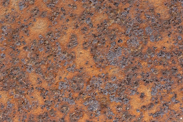 Flat lay of metal surface with rust
