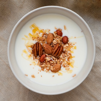 Flat lay milk with mix of nuts