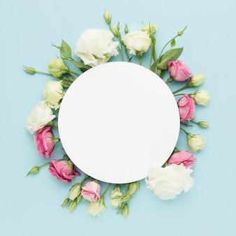 Flat lay mini roses with blank circle