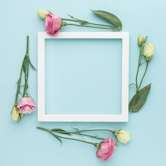 Flat lay mini roses with frame