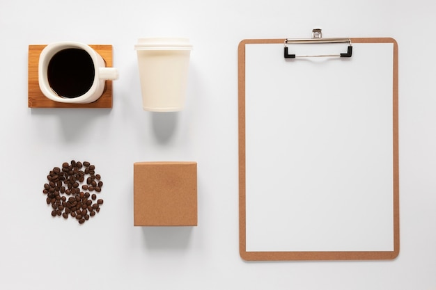 Flat lay minimalist assortment of coffee branding elements