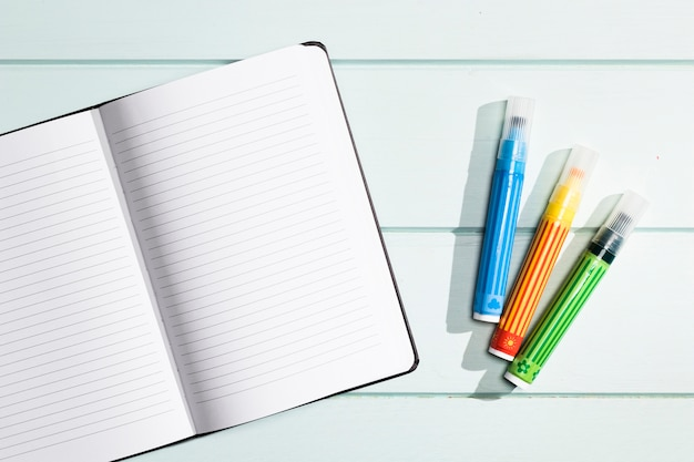 Flat lay minimalist notebook with highlighters