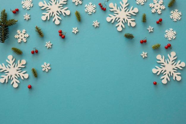 Flat lay minimalist white snowflakes and mistletoe