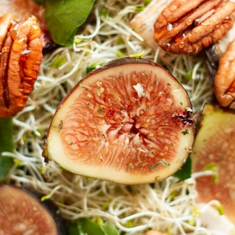 Flat lay mix of figs and nuts on plate