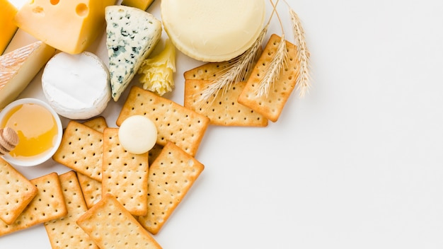 Flat lay mix of gourmet cheese and crackers with copy space