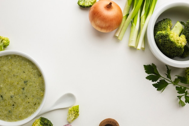 Flat lay mix of vegetables with broccoli bisque in bowl