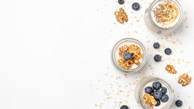 Flat lay mix of yogurt and fruits with copy-space
