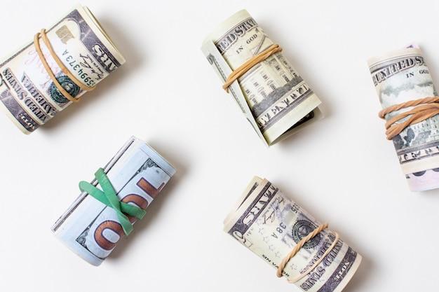 Flat lay of money tied with elastics