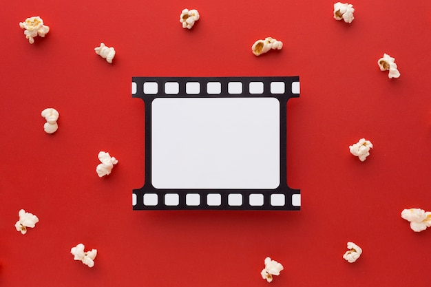 Flat lay movie elements on red background