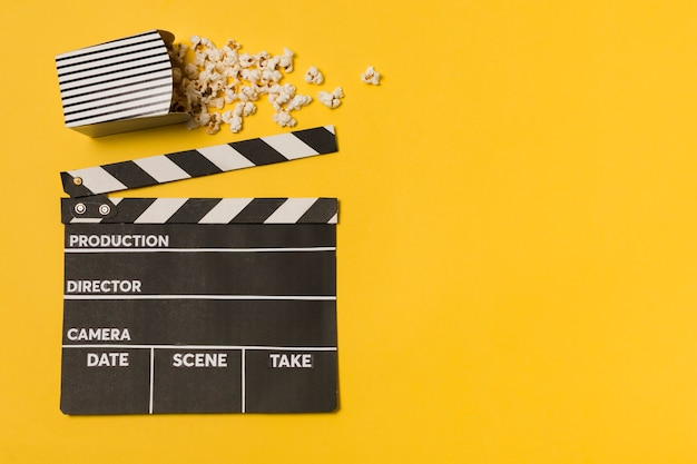 Flat lay movie slate with popcorn