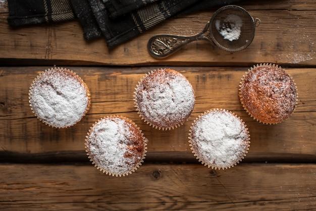 Flat lay muffins with powdered sugar