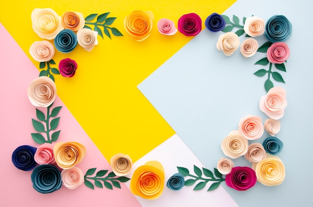 Flat lay multicolored background with flowers frame