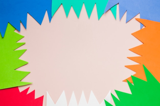 Flat lay of multicolored paper cut-outs for carnival