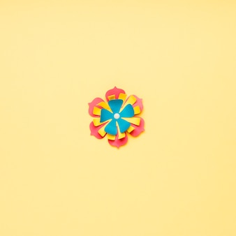 Flat lay of multicolored paper flower for spring