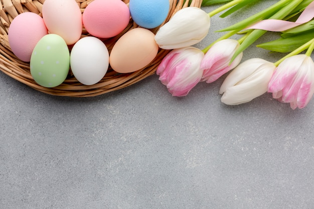 Flat lay of multicolored tulips and easter eggs