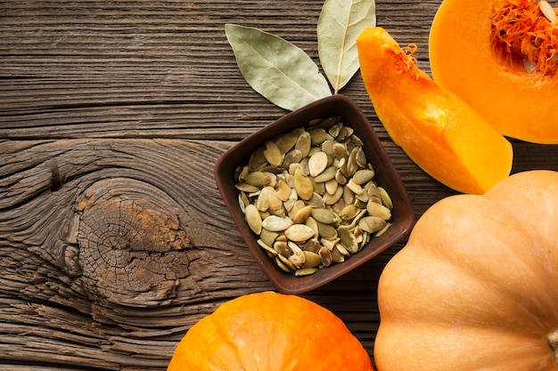 Flat lay mumpkin seeds and pumpkin