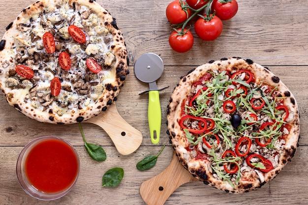 Flat lay mushroom and tomato pizza