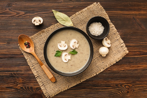 Flat lay mushrooms bisque and spoon
