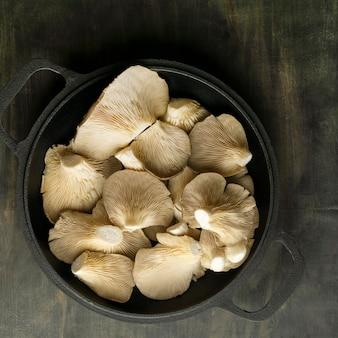 Flat lay mushrooms in pot