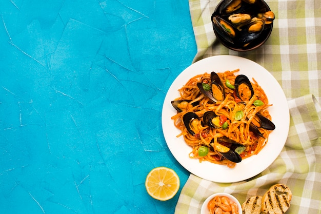 Flat-lay mussel pasta with copyspace