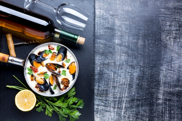 Flat-lay mussels in white sauce and wine with copyspace