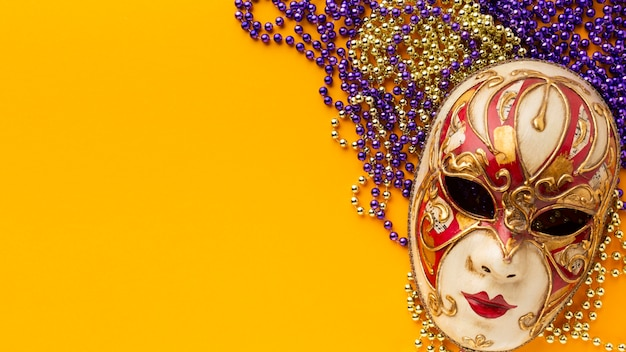 Flat lay mystery carnival elegant mask and pearls