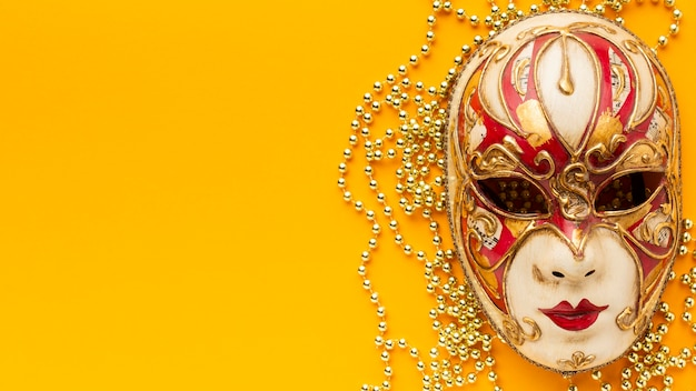 Flat lay mystery carnival elegant mask