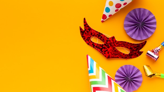 Flat lay mystery carnival masks and party hats