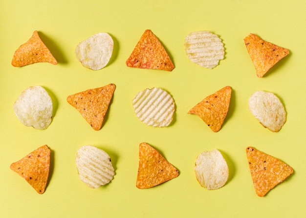 Flat lay of nacho chips with potato chips