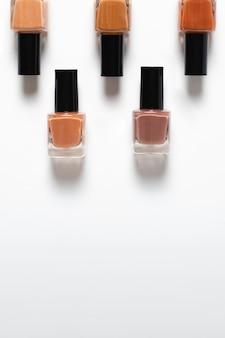 Flat lay of nail polish shades on plain background