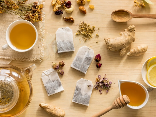 Flat lay of natural medicinal herbs with tea